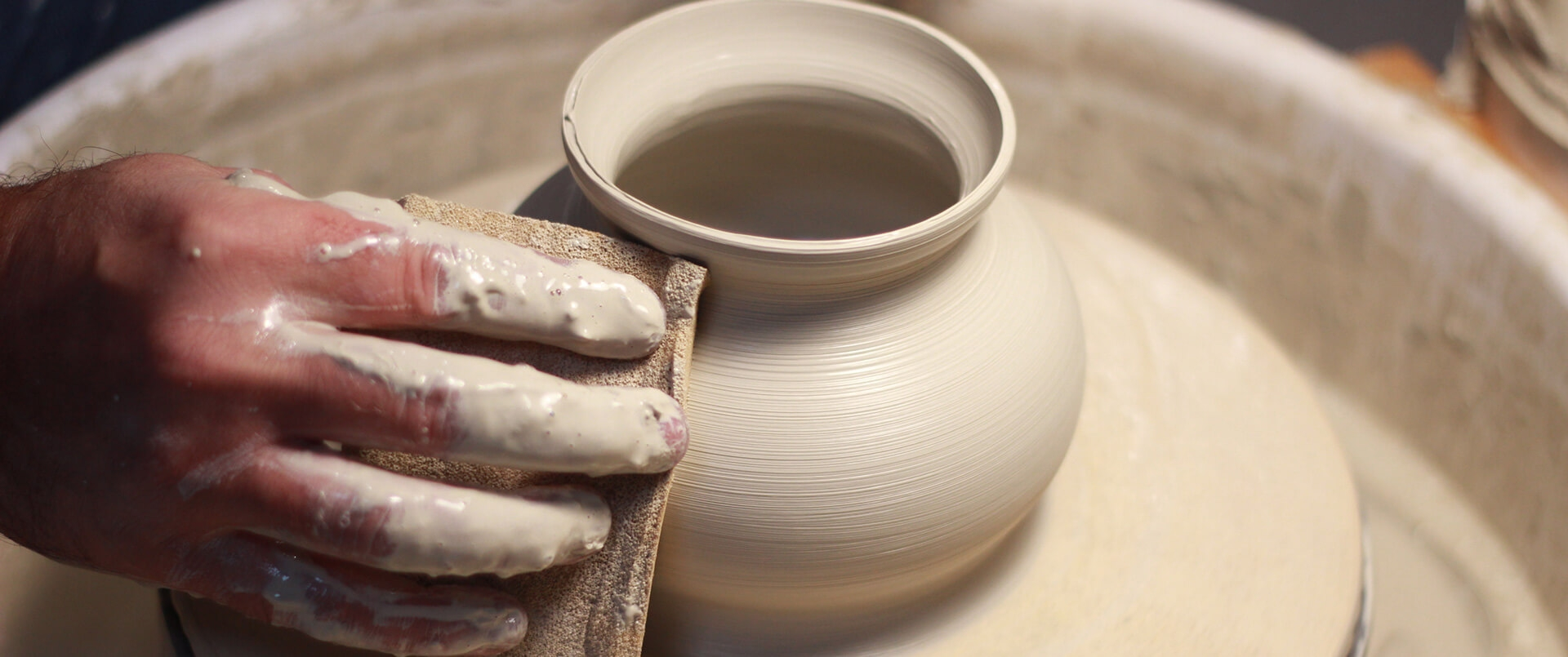 Bring clay to a potters wheel